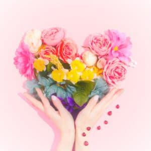 how to encourage someone - hands holding heart of flowers in pink