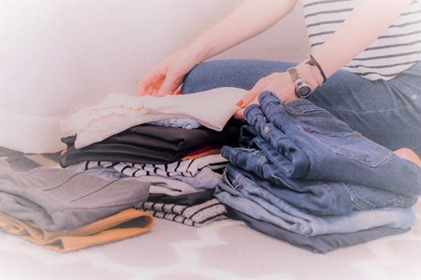 declutter for a cause - motivation to declutter blog post picture jeans sorting