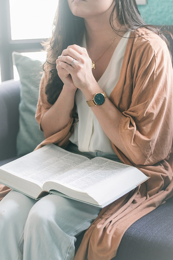 how to pray for your husband - woman with bible and watch