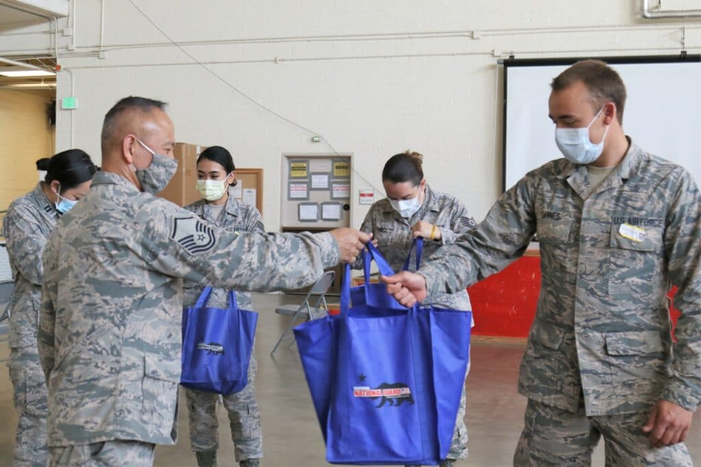 Operation Gratitude National Guard troops receiving bags
