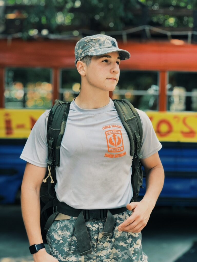 solder wearing a backpack - military care packages